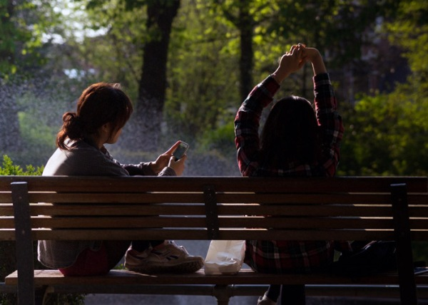 women on a bench