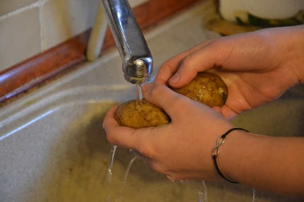 washing potatoes